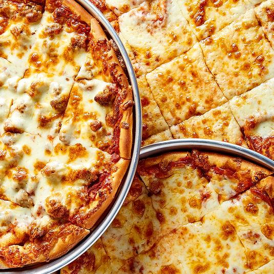Closeup shot of three pizzas