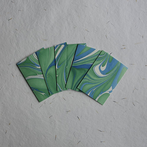 Set of five green marbled cards