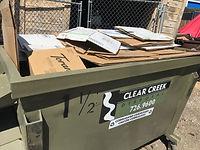Flattened Cardboard in dumpster.jpeg
