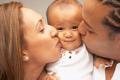 parents_kissing_baby2010-wide-big.jpg