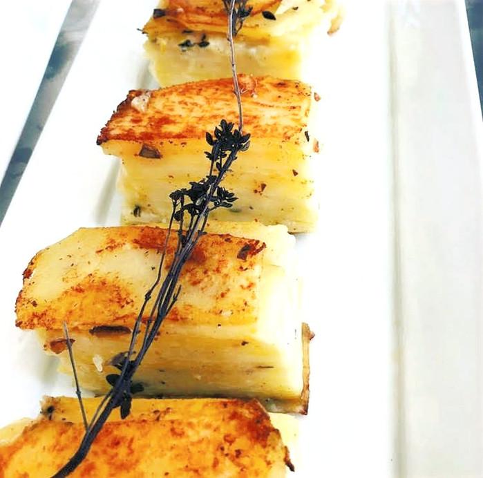 Potata pavés with lemon zest and thyme
