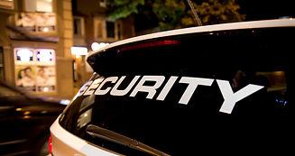 Security vehicle patrolling city at night.jpg