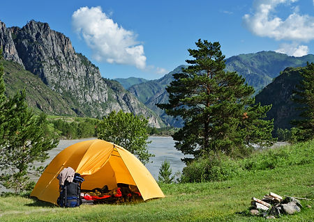 The Camping Tent near mountain river in