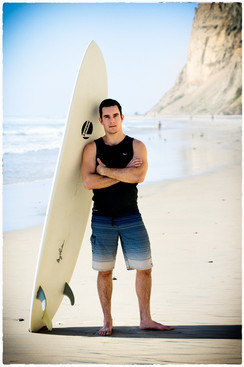 Ryan with surfboard.