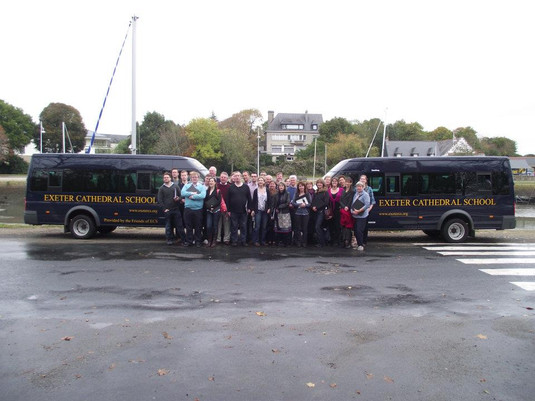 The choir and their minbuses, kindly loaned by Exeter Cathedral school