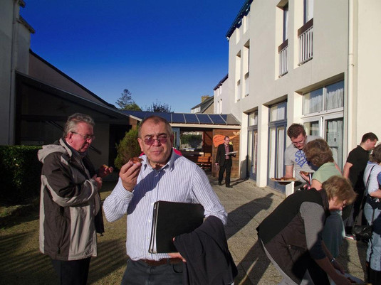 Chris Tippin, Phil Hobbs and others sampling the local cuisine