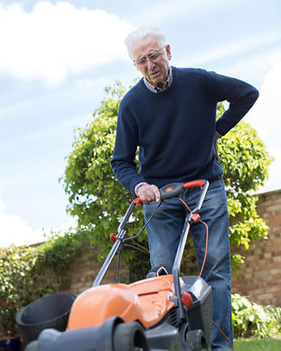Senior Man Suffering With Backache Whils