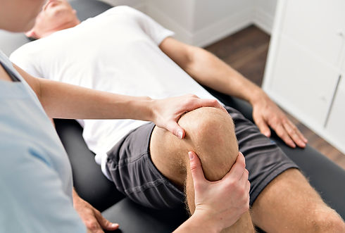 Patient at the physiotherapy doing physical exercises with his therapist_edited.jpg