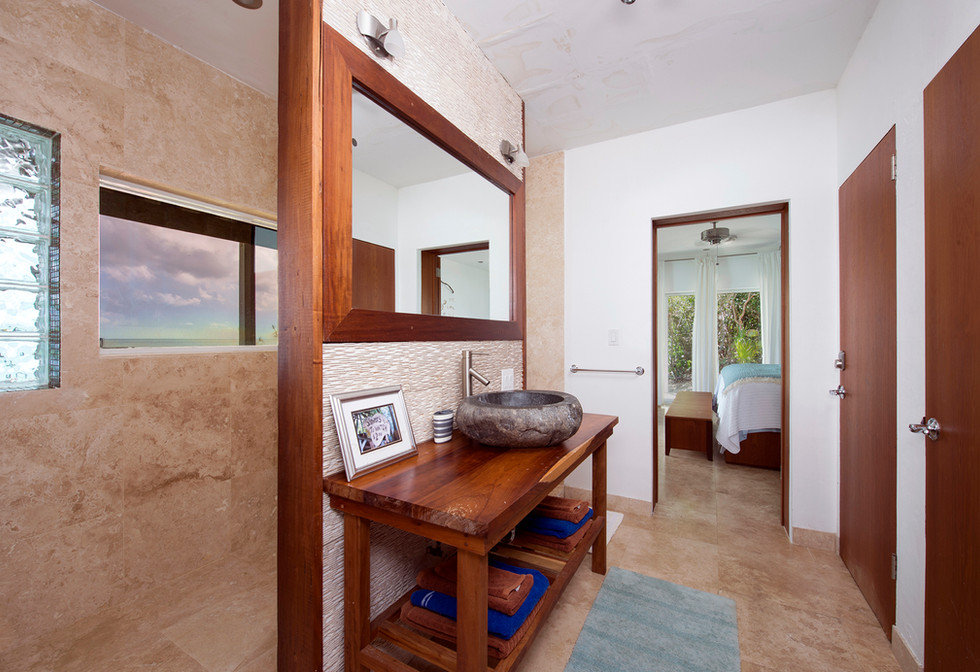 Custom bathroom with a 10 foot one way mirror to view the ocean from the shower.