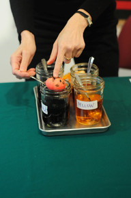 The egg is dipped into a jar of black dye