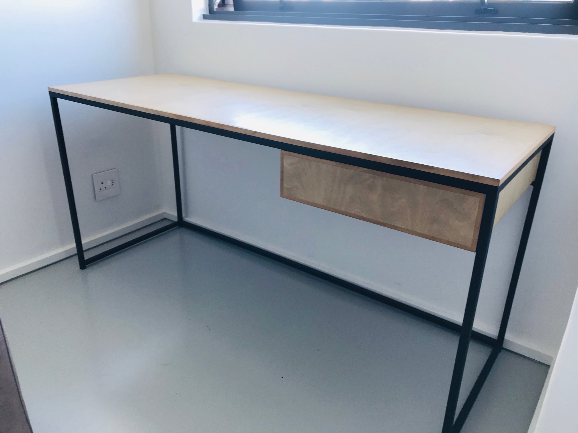 Office desks in steel and wood.