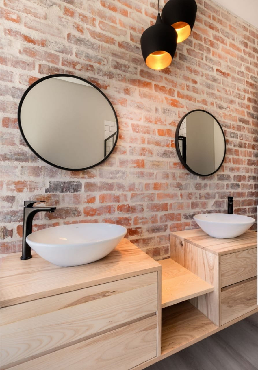 Ash vanities with industrial mirrors