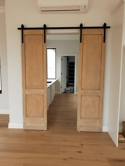 Double pantry door with mechanism.