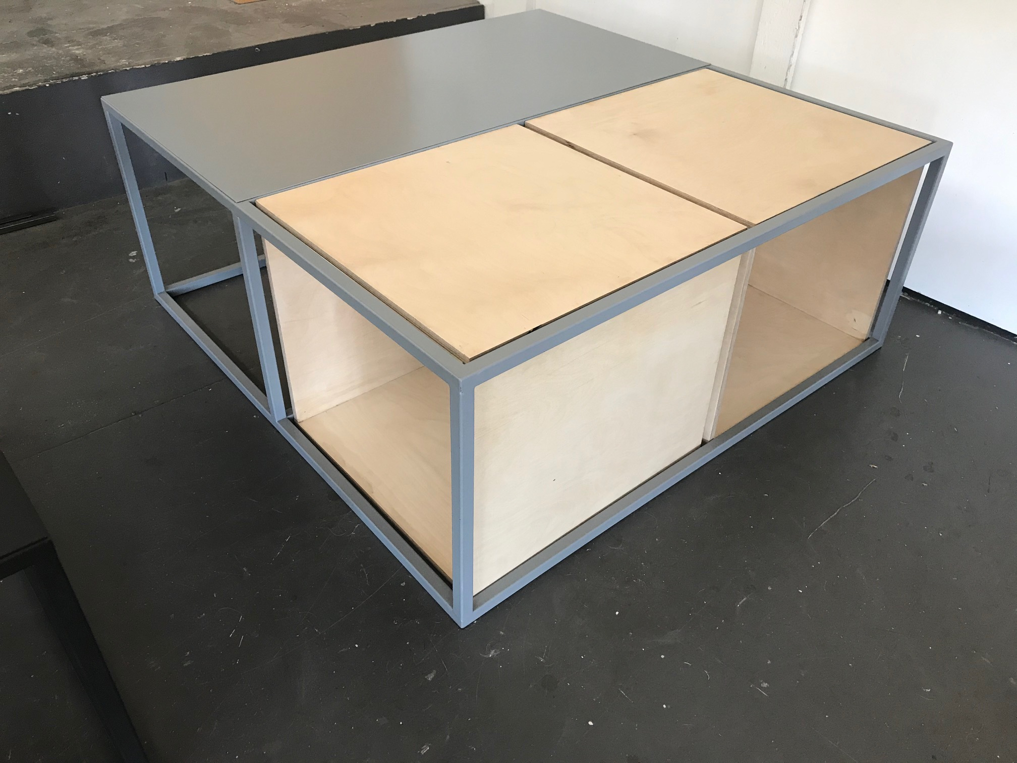 Steel and wood coffee table.