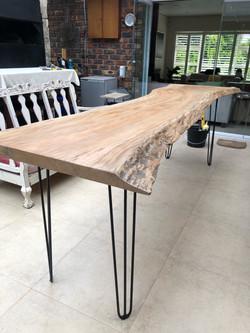 Salvaged live edge tree table
