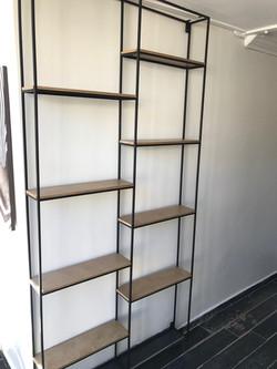 Vertical steel wall.