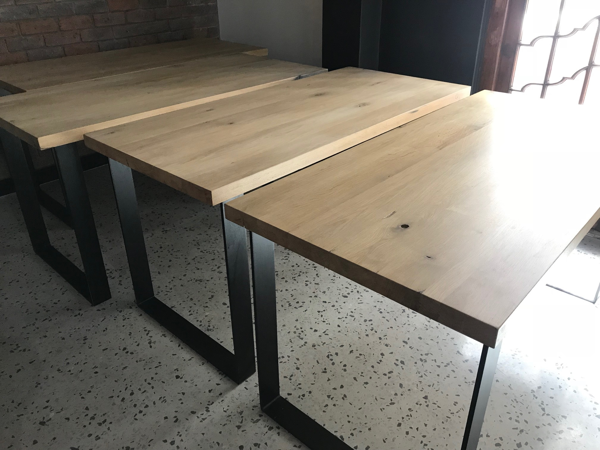Oak desks on steel legs