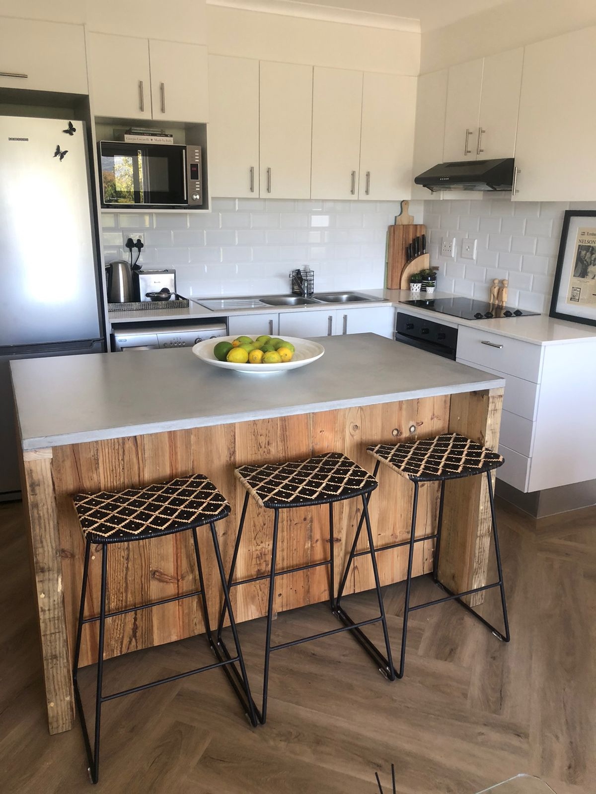 Kitchen island in cement top and recycled wood
