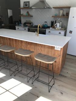 Kitchen island with bar stools.