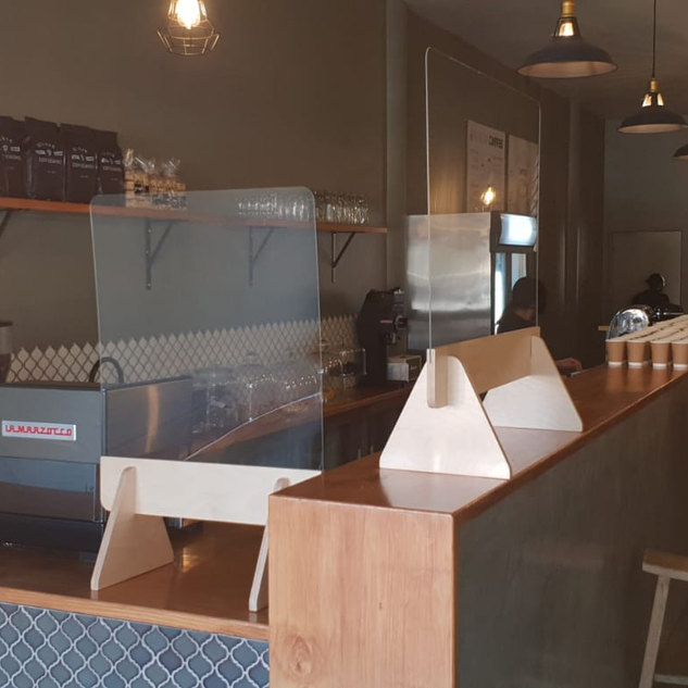 Coffee bar with sneeze screens