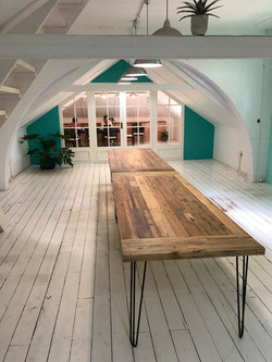 Rustic boardroom table seats 14