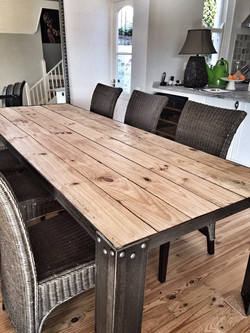 Large steel and wood table.