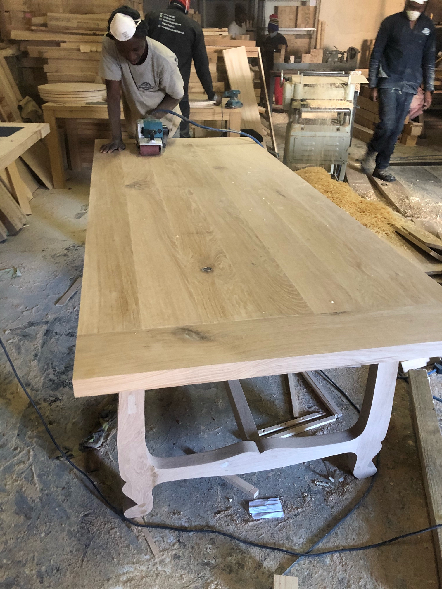 Oak dining room table heading for Greece