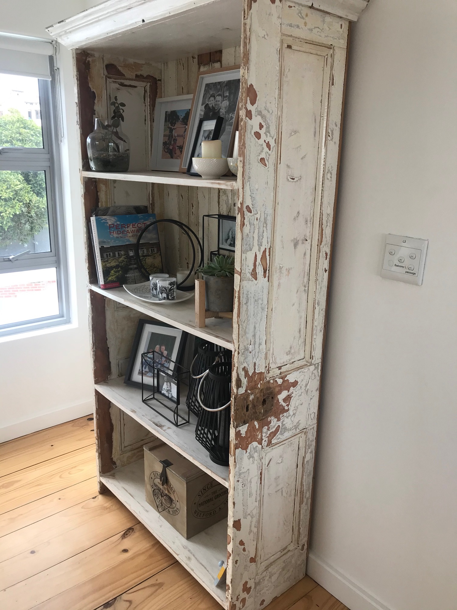 Recycled door for a rustic cupboard.
