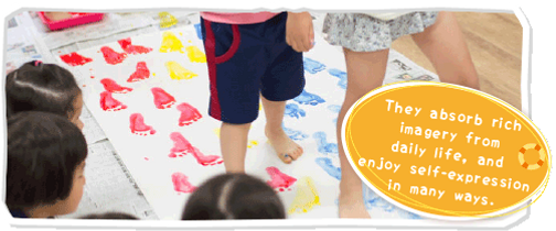 Play freely with paint during childcare