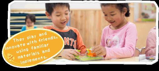 Older kindergarten children play with their ideas.
