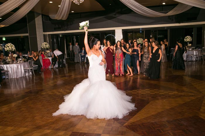 the bride throws the bouquet
