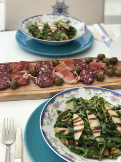 Pear salad and meat selection