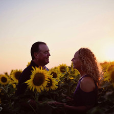 Couple in sunflowers