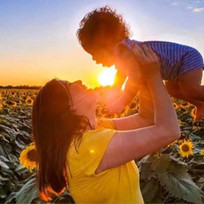 Mother and child at sunflowers