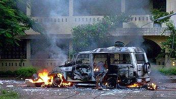 Car burns inside church grounds during 2008 Odisha Pogrom