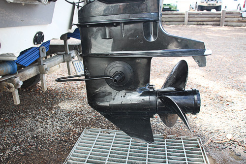 ear muffs attached to the water intake on an outboard motor