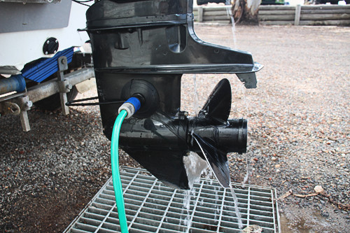 Hose attached to ear muffs on Mercury outboard motor