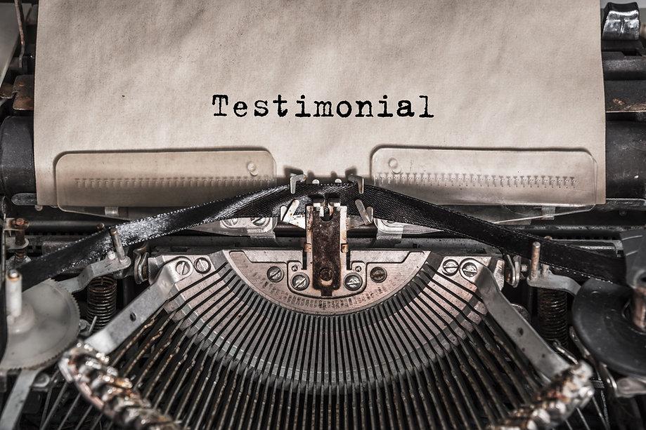 Testimonial message typed on old vintage typewriter. Close up..jpg