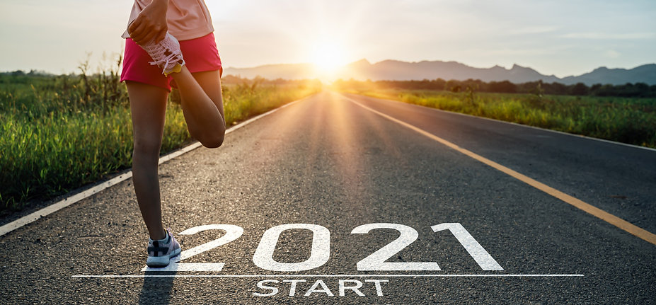 New year 2021 or start straight concept.word 2021 written on the asphalt road and athlete