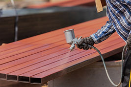 worker-spraying-paint-to-steel-pipe-to-p