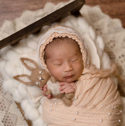 newborn in bed