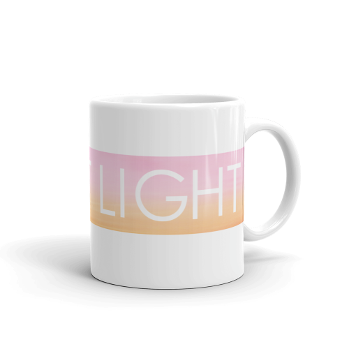 Inspirational 'Keep It Light' quote on a ceramic mug