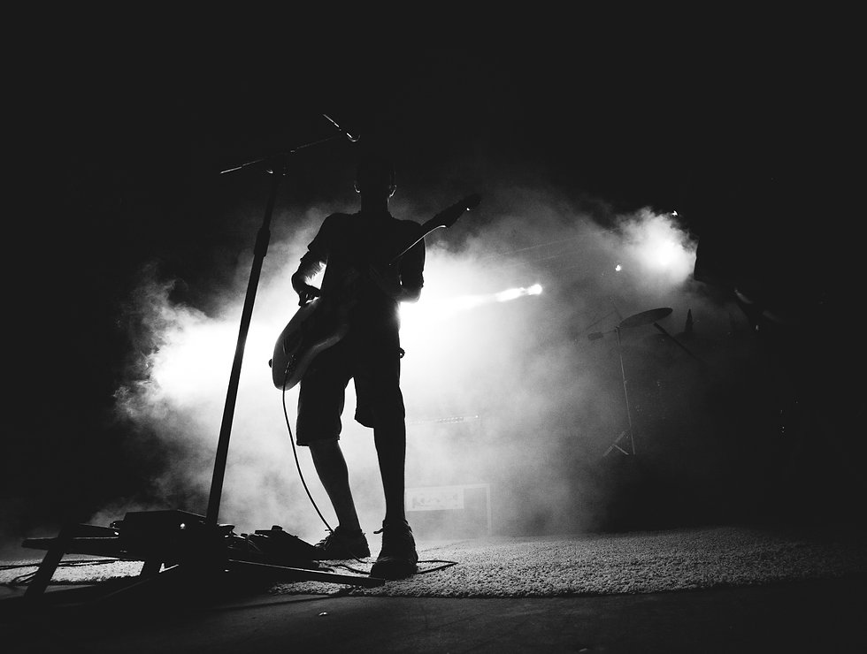 Silhouette of guitarist on stage