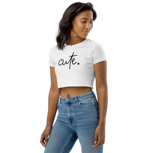 White coloured embroidered text saying the word cute on a crop top