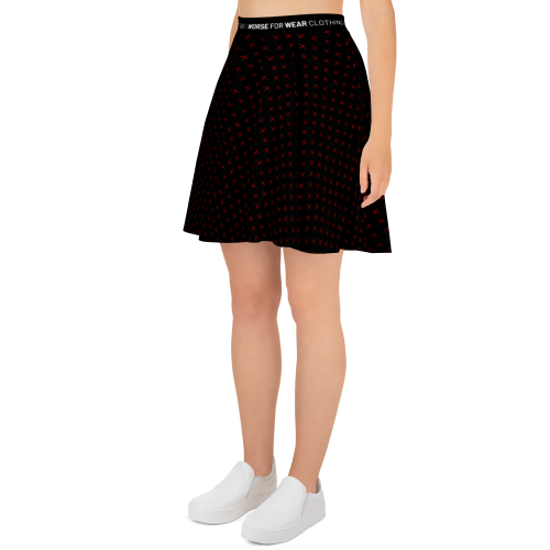 Red star style dots on a women's skater style black skirt