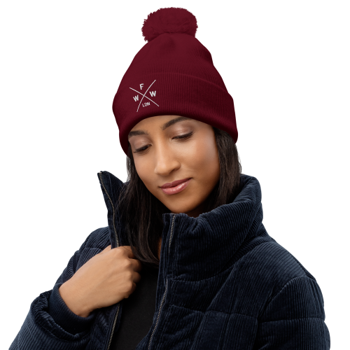 Emblem with London and Worse For Wear logo on a pom pom beanie hat
