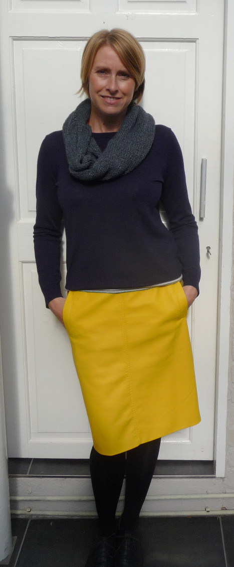 Shelley Kelly in yellow leather skirt and navy jumper