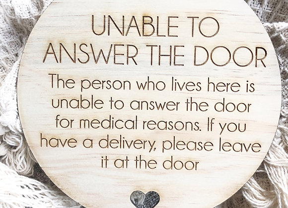 Unable to answer door sign