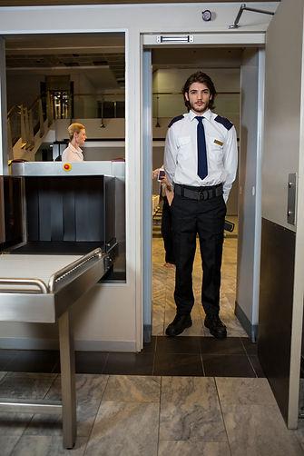 security-guard-standing-scanning-door.jp