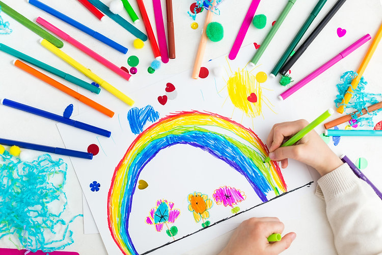 child-draws-rainbow-with-markers.jpg